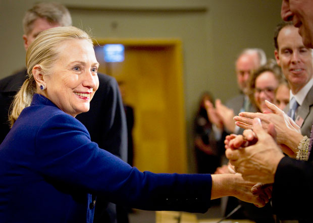 GREETING THE CROWD | U.S. Secretary of State Hillary Rodham Clinton, left, shakes hands after her speech on human rights issues at the United Nations headquarters in Geneva on Tuesday, Dec 6. (Anja Niedringhaus/Associated Press)