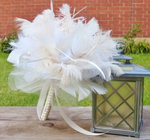 Feather Bouquet: A soft and elegant touch (also useful for the honeymoon too - wink, wink). Try to use common feathers that are either humanely collected or at least come from food sources so that one knows all parts are being used and not wasted.